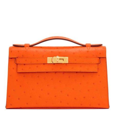 Hermes Tangerine Ostrich Mini Orange Gold Hardware Kelly Pochette For Sale at 1stdibs