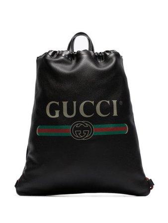 Gucci logo print leather drawstring backpack - FARFETCH