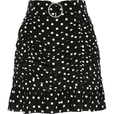 Black polka dot ruched mini skater skirt | River Island