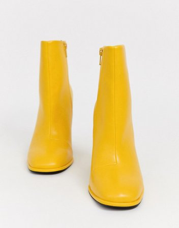 ASOS DESIGN Ending heeled ankle boots in yellow   ASOS