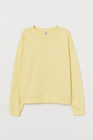Sweatshirt - Light yellow/Love - Ladies | H&M US