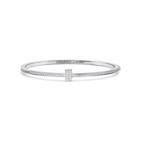 Tiffany T Two hinged bangle in 18k white gold with diamonds, medium.   Tiffany & Co.
