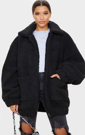 Black Oversized Borg Pocket Front Coat | PrettyLittleThing