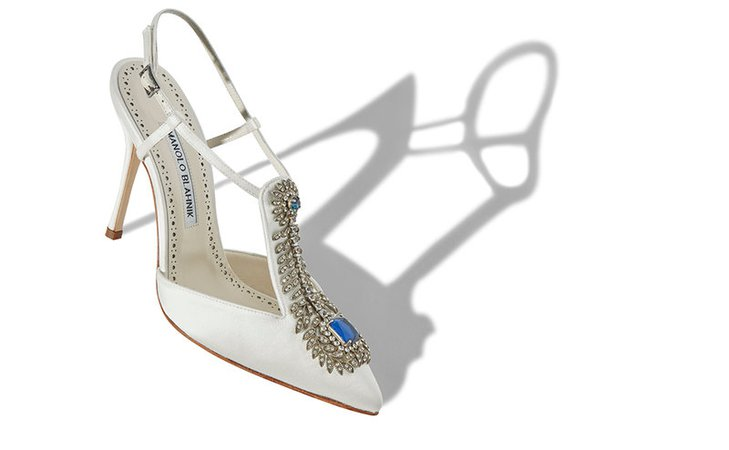 White pointed-toe heels with jewel detail