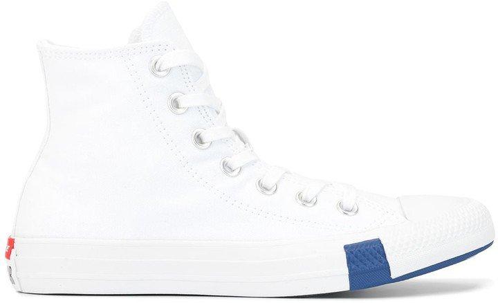 Play Chuck Taylor hi sneakers