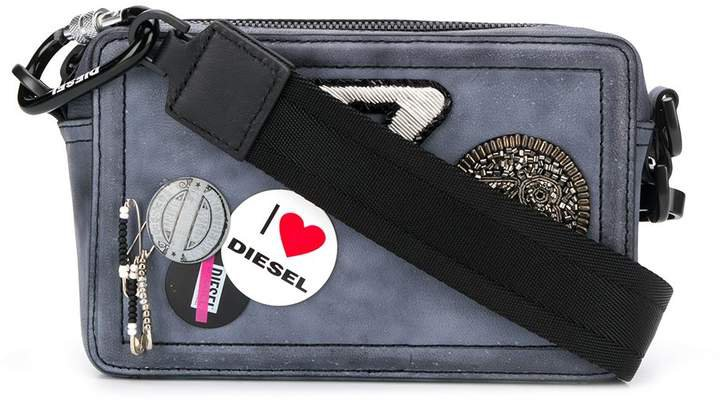 patch and badge embellished cross body bag