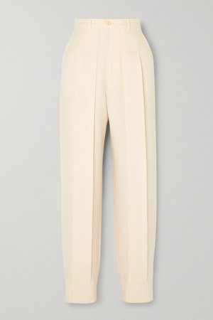 Ivory Pleated wool tapered pants | Gucci | NET-A-PORTER