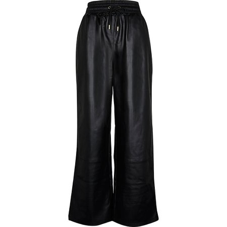 Black faux leather wide leg joggers | River Island
