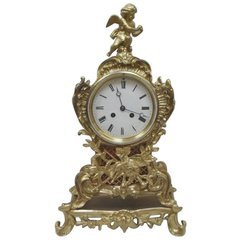 French Rococo Style Gilt Metal Mantel Clock For Sale at 1stdibs