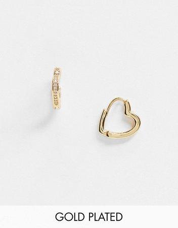 ASOS DESIGN 14k gold plated huggie hoop earrings in crystal heart shape | ASOS