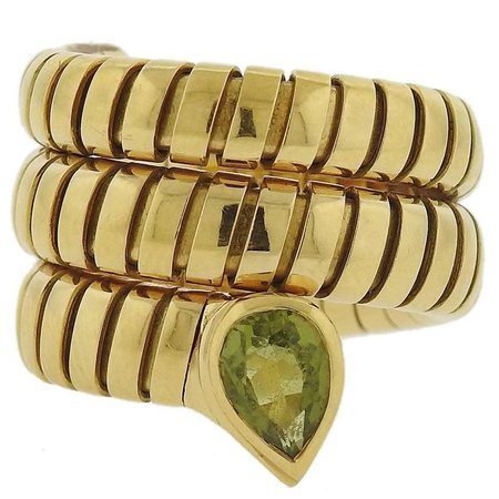 Bulgari Tubogas Gold Peridot Wrap Ring For Sale at 1stdibs
