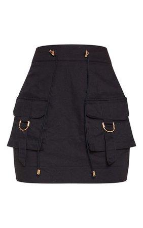 Black Cargo Pocket Detail Mini Skirt | Skirts | PrettyLittleThing