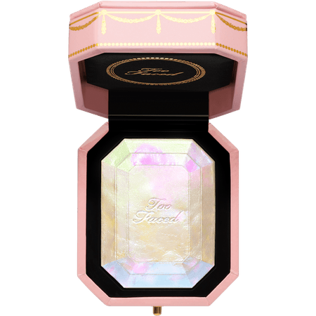The Diamond Highlighter from Too Faced will have you sparkling with this liquid to powder formula made with real diamond. Swirl the pink, blue, and gold shades to create your custom highlighter!