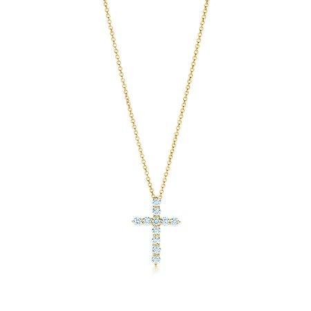 Cross pendant in 18k gold with diamonds