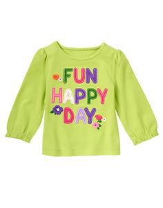 Off to a Fun Happy Day with our colorful tee brightened up with playful lettering and flowers.