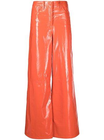 REMAIN patent wide-leg trousers - FARFETCH