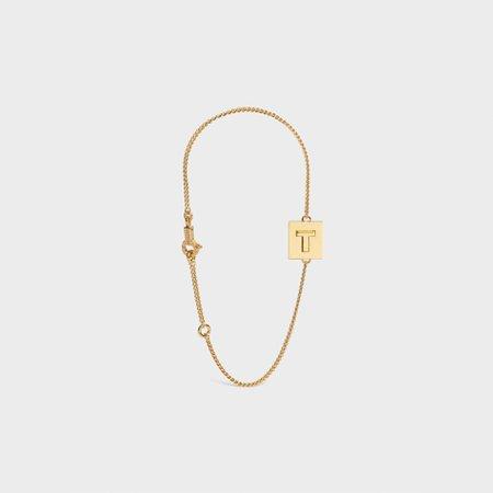 Celine Alphabet Bracelet in Brass with Gold Finish $590