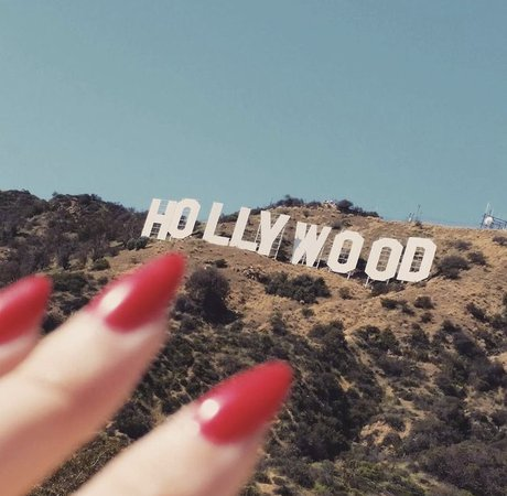 red nails hollywood sign aesthetic