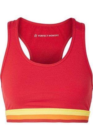 Perfect Moment | Cutout striped stretch sports bra | NET-A-PORTER.COM