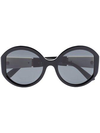 Shop black Prada Eyewear round frame sunglasses with Express Delivery - Farfetch