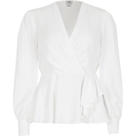 White long sleeve peplum wrap blouse | River Island