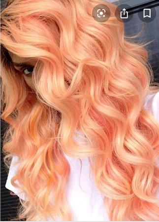pastel orange curly hair