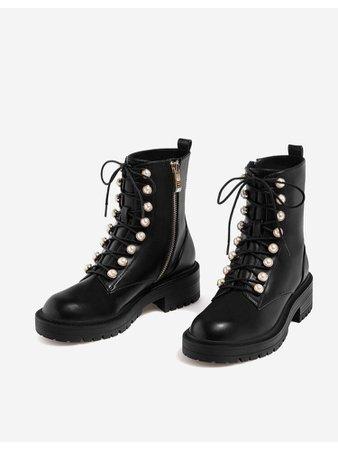Black button combat boots