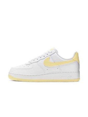 White and yellow Nike sneakers