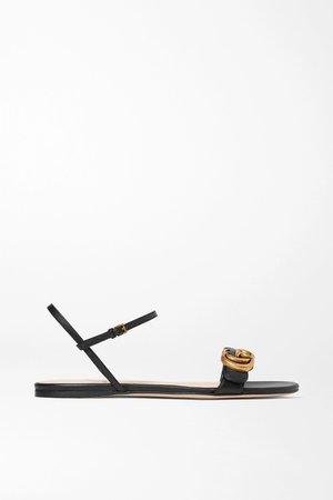 Black Marmont logo-embellished leather sandals | Gucci | NET-A-PORTER