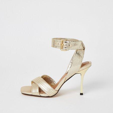 Gold metallic cross strap heeled sandals | River Island