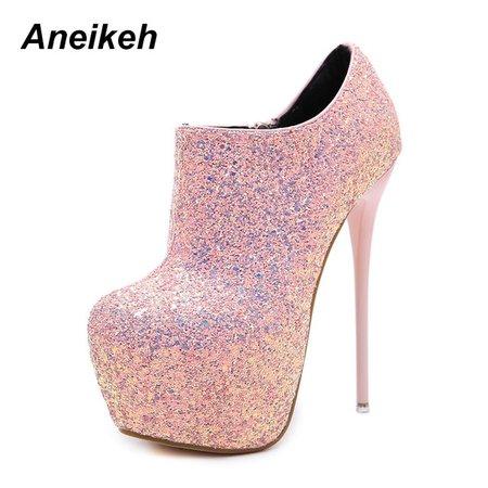Pink glitter high heel boots
