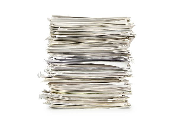 large-stack-of-papers-on-a-white-background-picture-id178580846 (612×405)