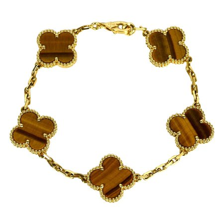an Cleef and Arpels 18K Yellow Gold/Tiger's Eye 5 Motif Vintage Alhambra Bracelet