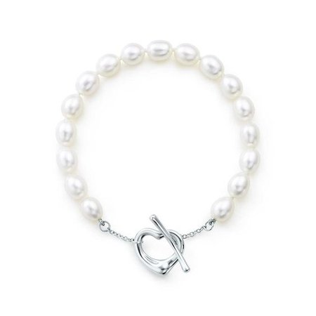 Elsa Peretti™ Open Heart pearl bracelet in sterling silver, medium.   Tiffany & Co.