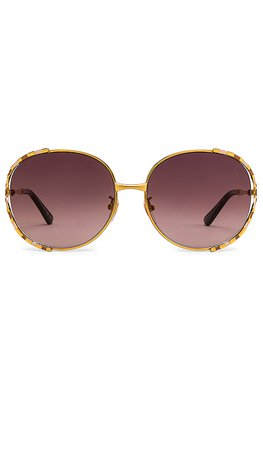 Gucci Round in Shiny Yellow Gold & Brown   REVOLVE