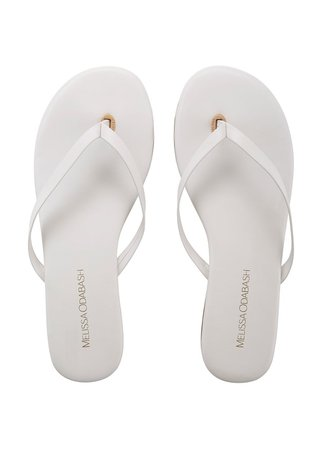 White fashion flip flops