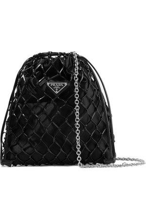 Prada | Macramé leather and satin bucket bag | NET-A-PORTER.COM