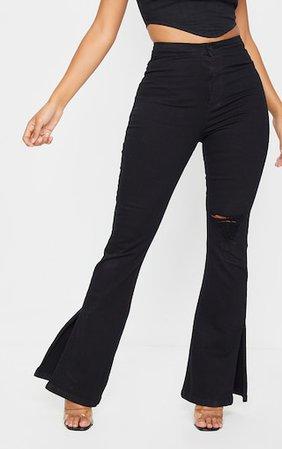 Shape Black Distressed Knee Split Hem Flared Jeans | PrettyLittleThing USA