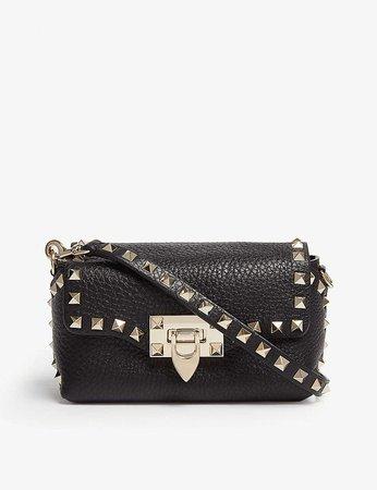 VALENTINO - Rockstud leather cross-body bag | Selfridges.com GBP775
