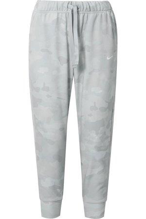 Nike   Rebel camouflage-print Dri-FIT track pants   NET-A-PORTER.COM