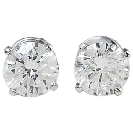 Cartier GIA Certified 4.03 Carat Diamond Stud Earrings at 1stdibs