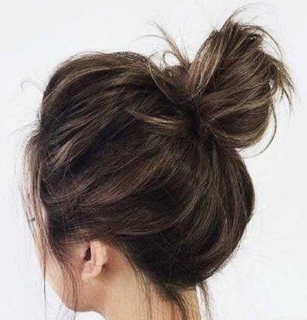 brown messy bun hair medium top knot hairstyle