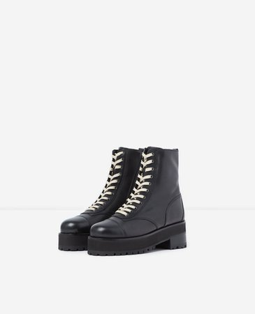 Black leather ankle boots with notched soles | The Kooples