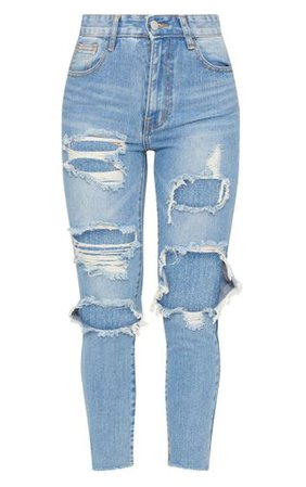 Light Wash Extreme Distressed Mom Jean   PrettyLittleThing
