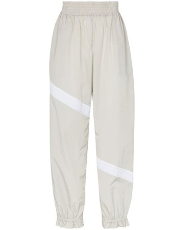 Ganni Striped Flared Cuff Track Pants | Farfetch.com