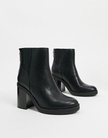 Bershka pull on chunky heeled boots in black   ASOS