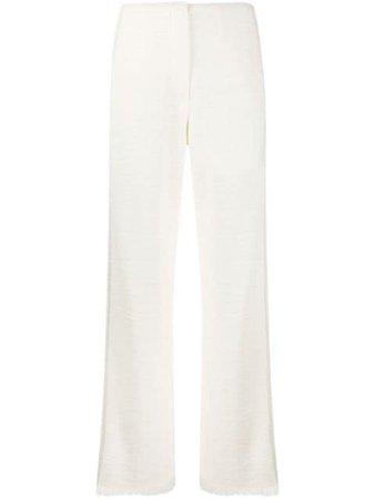 Nanushka Kyra frayed cuff trousers - Farfetch