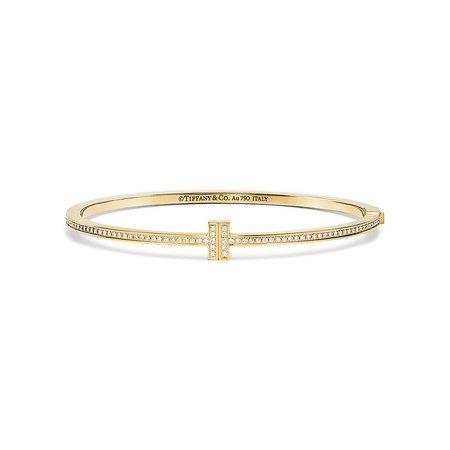 Tiffany T Two hinged bangle in 18k gold with diamonds, medium.   Tiffany & Co.