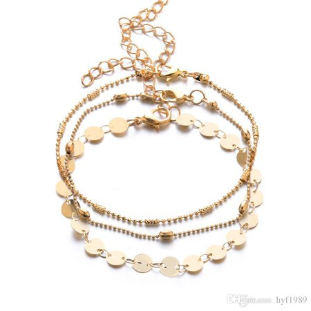 gold bracelets layered