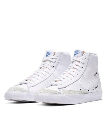Nike Blazer Mid '77 sneakers with metallic mini swoosh in white | ASOS